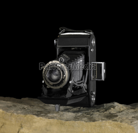 nostalgic camera on stone surface
