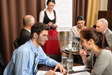businesspeople conference room waitress take order