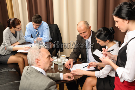 business meeting executives dealing at restaurant