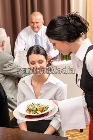 business lunch restaurant waitress serving woman