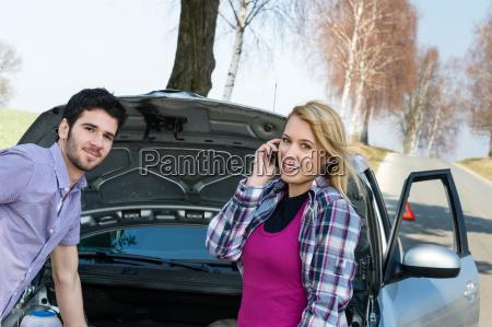 car breakdown couple calling for road