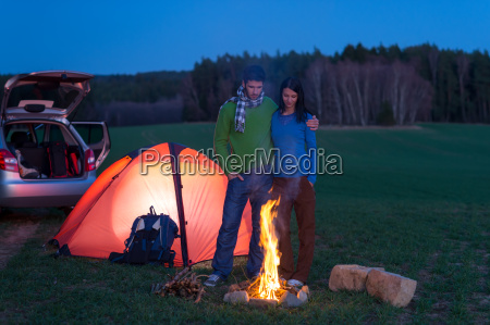 tent camping car couple stand by