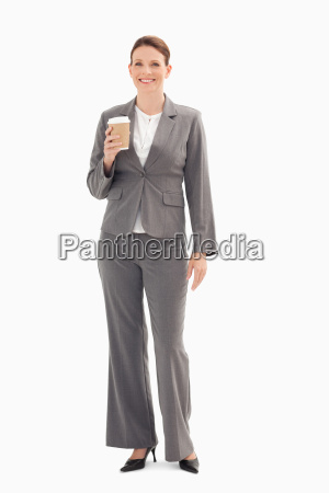 smiling businesswoman holding cup of coffee
