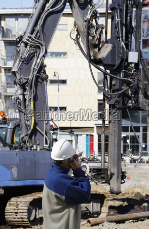 building worker and heavy machinery