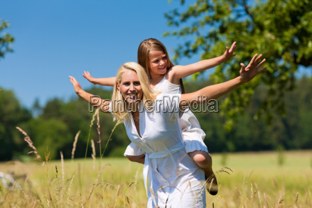 mother with daughter on a meadow