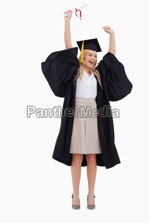 blonde student in graduate robe holding