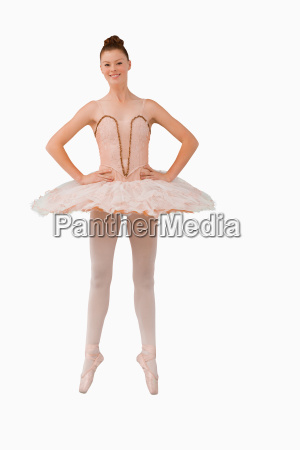 smiling ballerina standing on her tiptoes