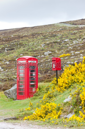 telephone booth and letter box near