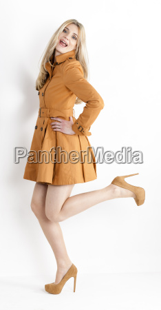 standing woman wearing brown coat and