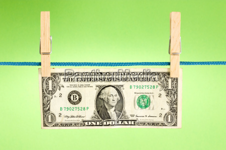 dollar hung over a green