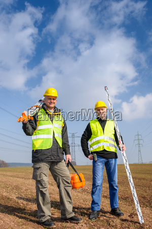 geodesist two man equipment on construction