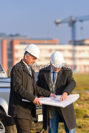 two architects man look at construction