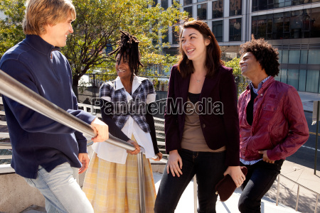 diverse group of friends laughing together