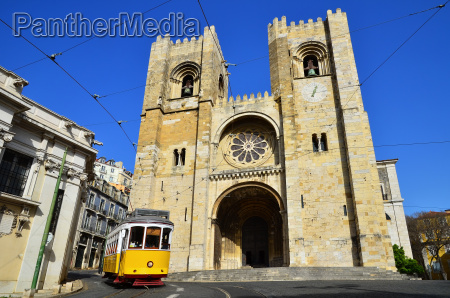 se cathedral and yellow tram lisbon