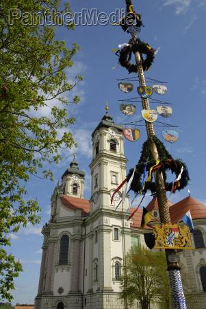 maypole against klosterkirche ottobeuren