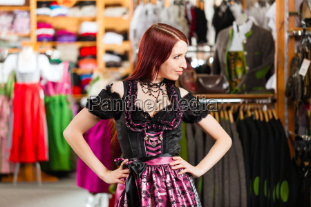 woman tasting traditional costume or dirndl