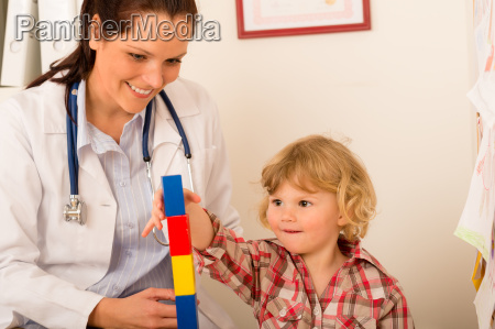 visit at pediatrician child girl playing