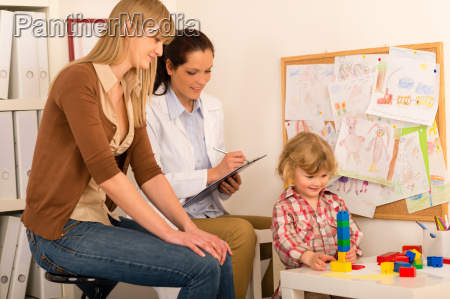 pediatrician observe child girl play at