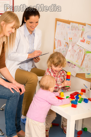 pediatrician female review children play activity