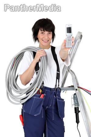 female plumber isolated on white background