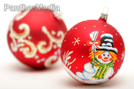 two red christmas balls with drawing
