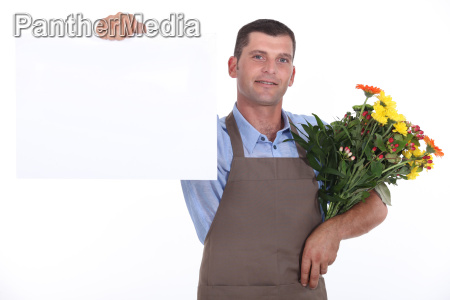 male florist with bunch of flowers