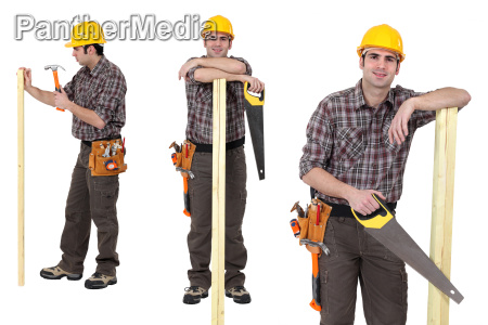 carpenter standing with plank of wood