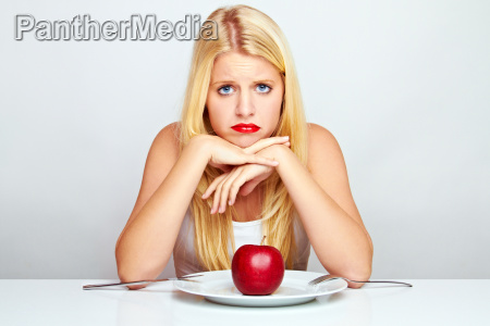 happy young woman eating fruit with
