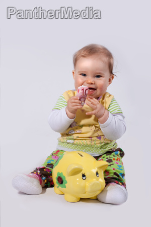baby with euro bill and piggy