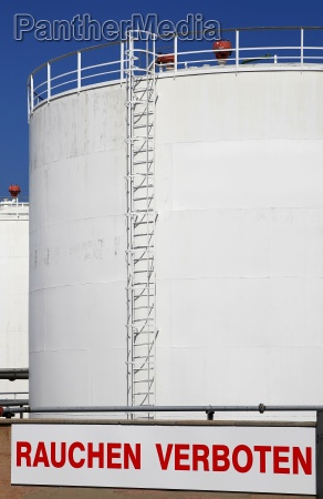 tank farm with a warning for