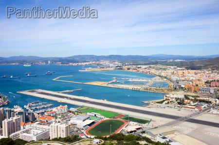 gibraltar runway and la linea cityscape