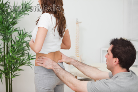 doctor sitting while examining the hips