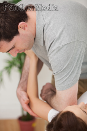 serious osteopath placing his elbow of