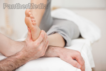 woman having a foot massage while