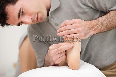 chiropodist making a foot massage