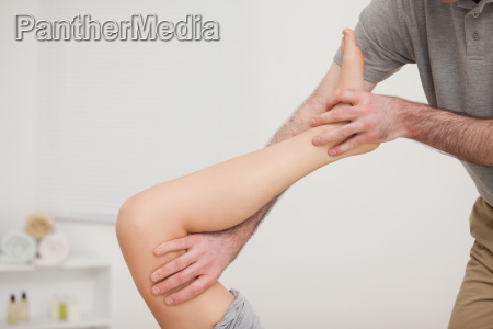 leg being stretched by a doctor