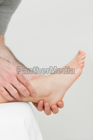 ball of a foot being held