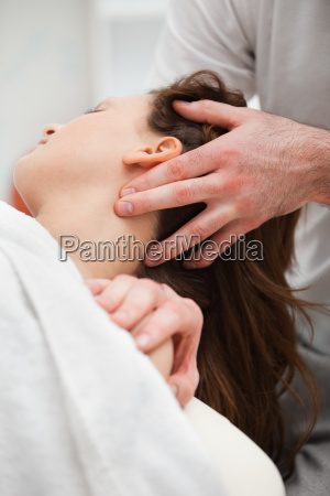 close up of chiropractor manipulating the