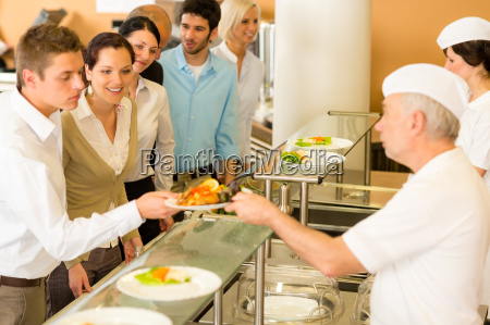office colleagues in canteen cook serve