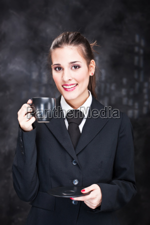 woman holding black cup of coffee