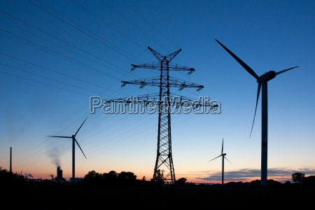 power pole and windmills at dusk
