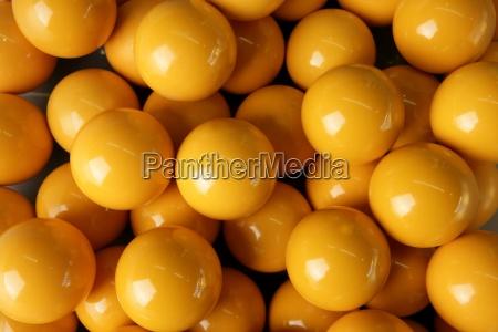 billiard many yellow balls rows background