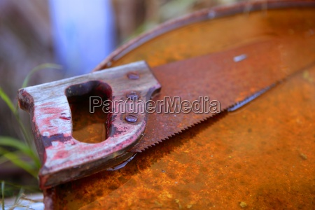 rusted old saw tool over rusty