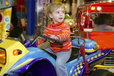 blond little girl in funfair fairground