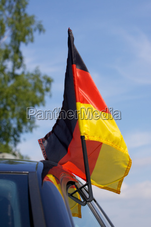 black car with german flag for