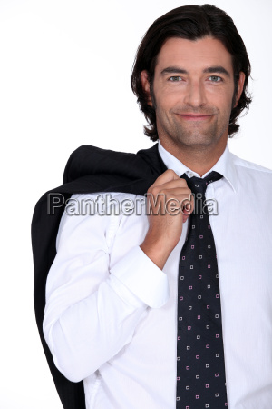 smiling businessman with his jacket over