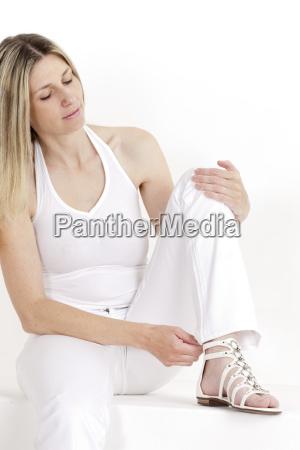 portrait of sitting woman wearing white