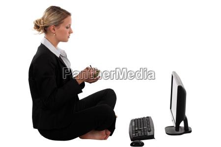 blond businesswoman sat cross legged in