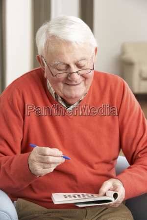senior man relaxing in chair at