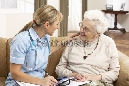 senior woman in discussion with health